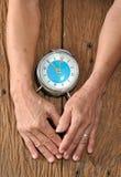 Starsza ręka i stary zegar obraz royalty free