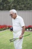 Starsze osoby Obsługują z Sztuczną kręgle ręką, piłką i Zdjęcia Royalty Free