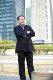 Starszego Azjatyckiego biznesmena uśmiechnięty portret Obrazy Royalty Free