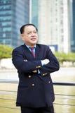 Starszego Azjatyckiego biznesmena uśmiechnięty portret Fotografia Stock
