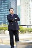 Starszego Azjatyckiego biznesmena uśmiechnięty portret Zdjęcia Royalty Free