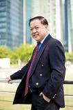 Starszego Azjatyckiego biznesmena uśmiechnięty portret Obraz Royalty Free