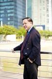 Starszego Azjatyckiego biznesmena uśmiechnięty portret Zdjęcie Stock