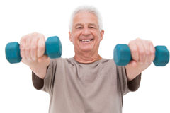 Starszego mężczyzna udźwigu ręki ciężary Fotografia Royalty Free