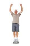 Starszego mężczyzna doping na ciężar skala Zdjęcia Royalty Free