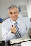 Starszy biznesmen opowiada klient Zdjęcia Stock