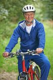 Starszy mężczyzna Cieszy się cykl przejażdżkę W wsi fotografia royalty free