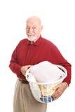 Starszy mężczyzna z pralnią fotografia stock