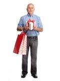 Starszy mężczyzna z prezentem Obraz Royalty Free
