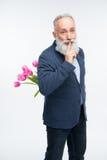 Starszy mężczyzna z tulipanami obrazy royalty free