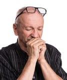 Starszy mężczyzna zakrywa jego twarz z ręką Fotografia Royalty Free