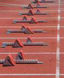 Start on 100 meters. Starting blocks at the start Royalty Free Stock Images