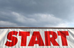 Start. Red Start sign with cloudy sky in the background Royalty Free Stock Image