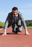 Start. Young businessman on a track Stock Photo