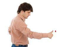 Start!. Young man presses red button Royalty Free Stock Photo