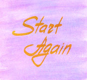 Start Again card. Start Again hand written golden lettering on pink watercolor background Stock Images