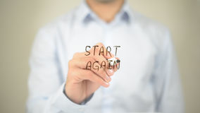 Start Again, Man Writing on Transparent Screen Stock Photos