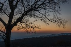 First hint of sun at sunrise Royalty Free Stock Photo