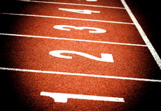 Start on athletics running track Stock Images