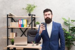Start awesome working day. Man bearded manager businessman entrepreneur hold cup of coffee. Relaxed thoughtful top stock images