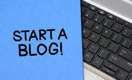 Start a Blog words with keyboard closeup top view.  royalty free stock image