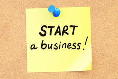 Start a business! Text on a sticky note pinned to a corkboard. 3 Stock Photography