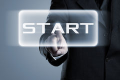 Start button pressed by businessman Royalty Free Stock Photos