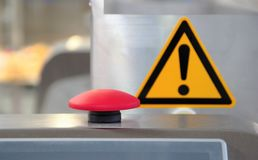 Start button, stop red, near the attention sign. selective focus. royalty free stock photo