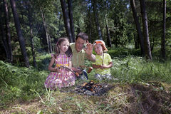 Start campfire  with a magnifying glass Stock Images