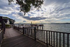 This is the start of Changi coastal boardwalk from Changi Beach club. It offers beautiful view of coconut trees and the high. Beautiful scenery along Singapore stock photo