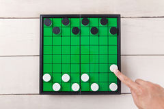 Start checker game on green board view from above on table. Start checker game on green board view from above on wood table stock photo
