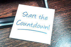 Start The Countdown Reminder On Paper On Wooden Cupboard. A Start The Countdown Reminder On Paper On Wooden Cupboard Stock Photography
