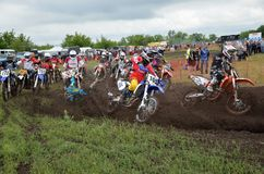 Start crash the motocross group of riders Royalty Free Stock Image