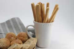 Bagutte , whole wheat Bread and Italian Bread Sticks, Grissini , on White Background. Start a day with healthy food, good to be a light meal, served with Butter royalty free stock photography