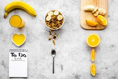 Start the day the right way. Healthy breakfast oatmeal with fruits and planning the day. Grey background top view Stock Photo