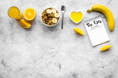 Start the day the right way. Healthy breakfast oatmeal with fruits and planning the day. Grey background top view Stock Image