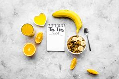 Start the day the right way. Healthy breakfast oatmeal with fruits and planning the day. Grey background top view Stock Photos