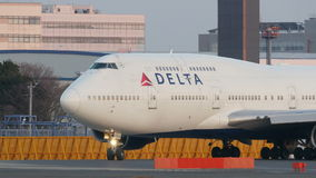 Start Delta Airliness Boeing B747 in Narita stock footage