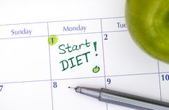 Start Diet in calendar with pen and green apple Royalty Free Stock Images