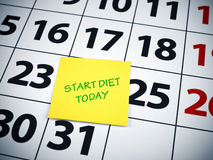 Start diet today. Written on a sticky note on a calendar stock images