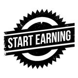 Start Earning rubber stamp Royalty Free Stock Photos