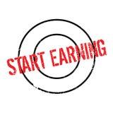 Start Earning rubber stamp Stock Photo