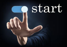 Start. Finger pointing on a start button Stock Photography