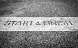 Start and Finish. Black and white street start and finish line stock image