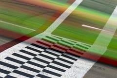 Start Finish Line. Race cars blur pass the start finish line Stock Photos