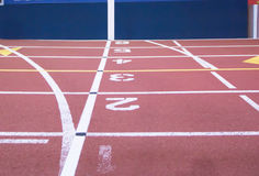 The start and finish line at an indoor track stock photo