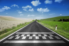 Start and finish pattern line on country road. Finish and start pattern line on the sunny straight asphalt country race road royalty free stock images