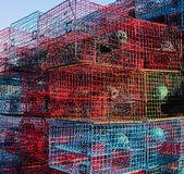 Crab traps on a crabbing boat. At the start of the fishing season, a commercial crabber at a dock in Madisonville, Louisiana, with colorful traps loaded on his Royalty Free Stock Images