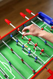 Start the game. Football about to be dropped to start the game of table football Stock Photo