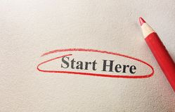 Start Here. Red circle and pencil with Start Here text Royalty Free Stock Images